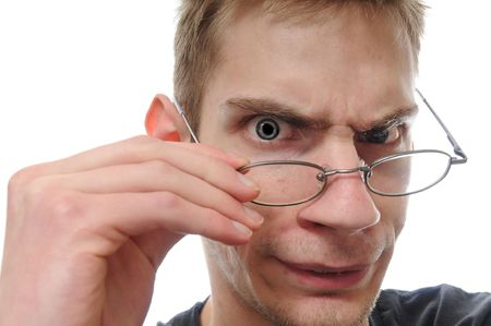 taking inventory: A curious white nerdy male takes down his glasses to closely inspect, examine and study his investigation.