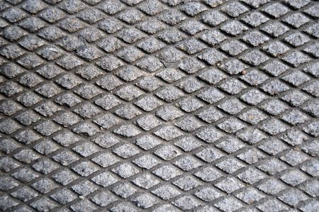parallelogram: Cement grid indentation in asphalt. This makes a great grungy background texture. Stock Photo