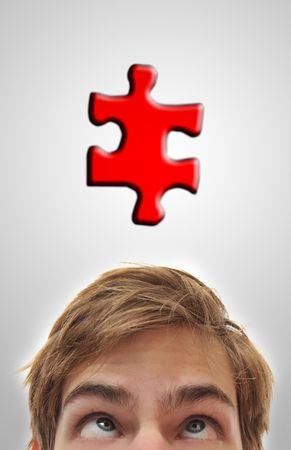 Man looking up at puzzle piece, problem solving his mind out.