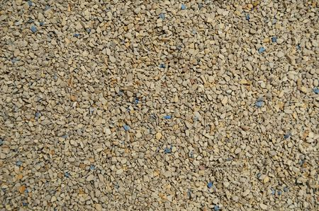 Kitty Litter Background Texture with clean new brown, gray, and blue rocks mixed in. photo