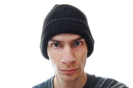 hijacker: Un adolescente problem�tico mira fijamente intensamente en el visor, aislado sobre fondo blanco.