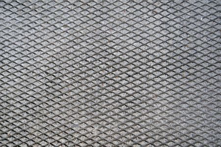 indentation: Cement grid indentation in asphalt. This makes a great grungy background texture. Stock Photo