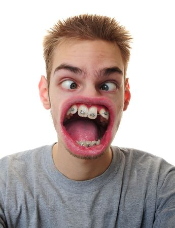 manipulation: A young adult white Caucasian male screaming his message furiously isolated on white background.