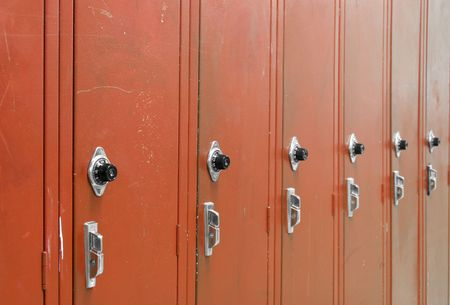 corridors: Red High School Lockers with a spin dial for the combination code. Stock Photo