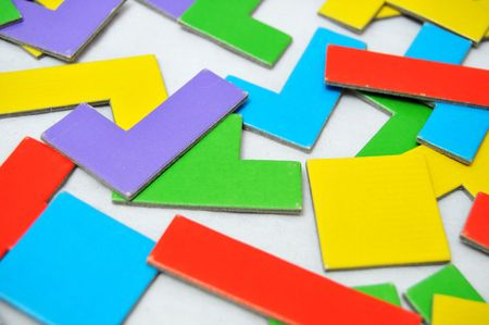 Abstract colorful 80s shapes scattered on a white floor. photo