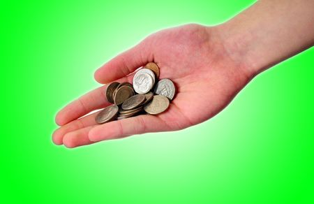 White Caucasian hand holding money out isolated on green background in the palm of his hand. Stock Photo - 6295312