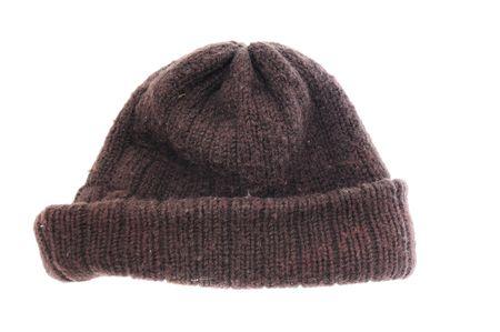 Een dikke bruine wol muts hoed GLB perfect voor winterweer. geïsoleerd op een witte achtergrond.
