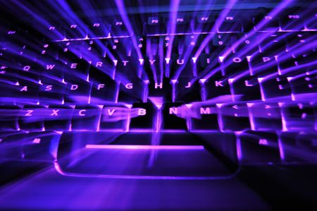 backlit keyboard: A purple glowing backlit illuminated keyboard with bursting light in between the keys Stock Photo