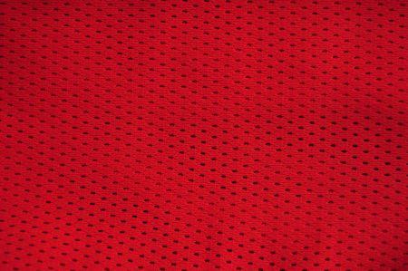 breathable: Close up di nylon poliestere rosso rosso basket sportswear pantaloncini creare uno sfondo con texture.