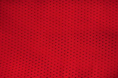 Close up of red polyester nylon red basketball sportswear shorts to created a textured background. photo