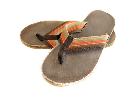 sandles: Pair of brown and orange retro Jamaican junglist sandals isolated on a pure white background