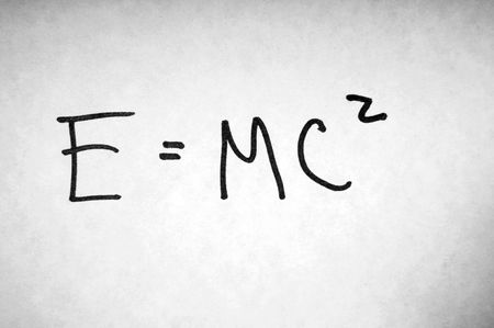 mathematical proof: A famous mathematical formula written on paper: E=MC^2. Stock Photo
