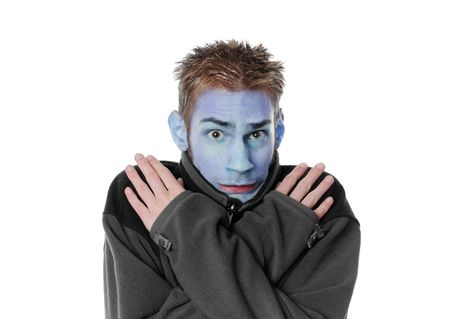 Man shivering with a blue face isolated on white background. Young white adult.