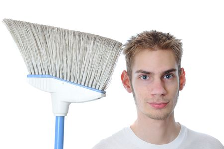 sitter: Young white Caucasian male adult janitor custodian employee smiles with his broom. Isolated on white background.