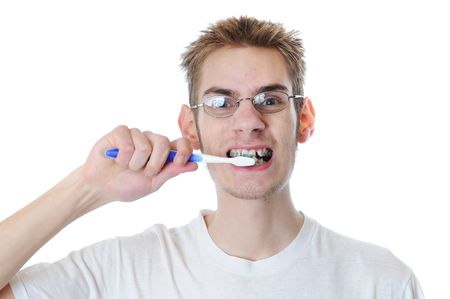 Young adult man brushes teeth isolated on white. He has braces. Stock Photo - 6408229