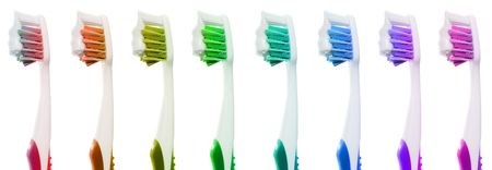 Blue toothbrush with fresh new toothpaste on the bristles isolated on white background.   Stock Photo - 6408191