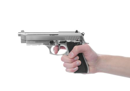 45 gun: Hand holding a handgun pistol 357 Magnum isolated on white background. Deadly weapon