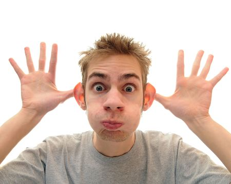 animal idiot: A young adult man makes a silly monkey face over a pure white background Stock Photo
