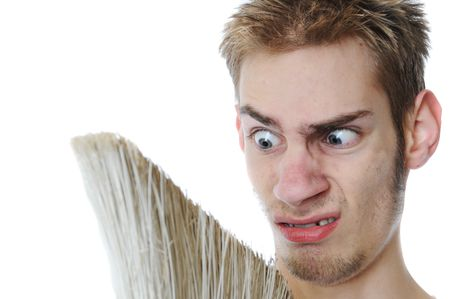 sitter: Young white Caucasian male adult janitor custodian employee with his broom. Isolated on white background.