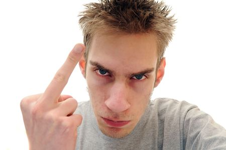 insulting: Young adult man flips the bird off. This is an insulting sign used in American culture. Archivio Fotografico