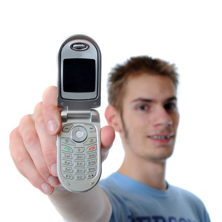 18 year old: Young 18 year old adult teenager shows his new miniature 3G cell phone to the viewer isolated on white background. Stock Photo