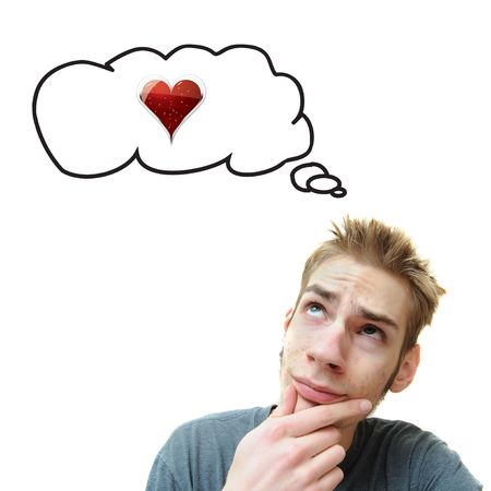 A young white male adult thinks about love. A red heart can be seen in his think bubble. Isolated on white background.