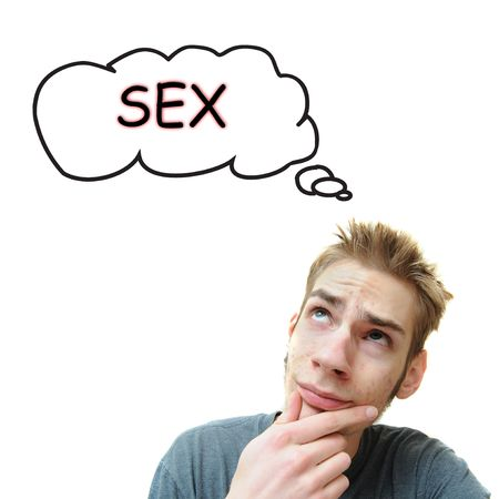 sex education: A young white male adult thinks about sex. Isolated on white background.