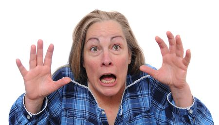 fear: Insane woman screaming for her life in shock and fear. Isolated on white background