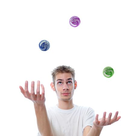 trickster: Young man juggling several multicolored balls at once, This concept also applies to multitasking.