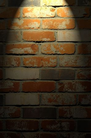 Clean red and tan brick wall background texture with spotlight