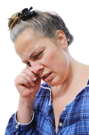Middle aged woman with stressed out, rubbing her eyes. isolated on white