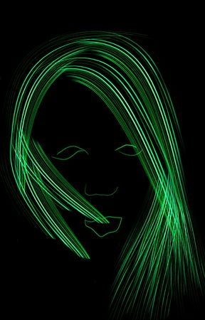 Hair style on an abstract head. You can see the outline of her eyes, lips, and nose. Everything is glowing green