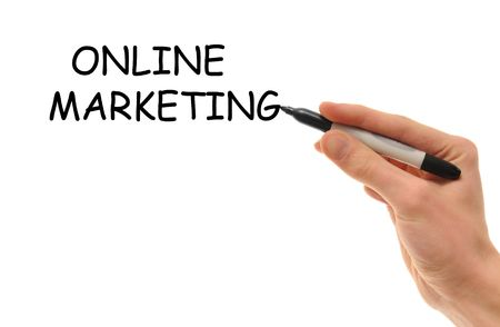 Online Marketing being written by a white Caucasian hand holding a marker with empty blank white copy space below with room for your text Stock Photo