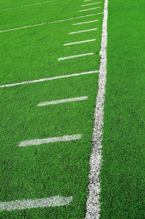 An abstract closeup of an American football field lines on artificial green turf photo