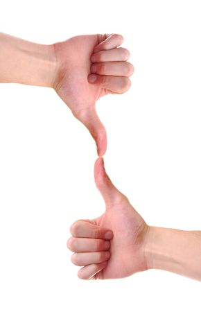 Isolated white Caucasian hands with thumbs up and thumbs down with each thumb touching eachother. photo