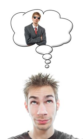 Young man sees and visualizes himself wearing a business suit in his think bubble above his head isolated on white background Stock Photo - 6708396