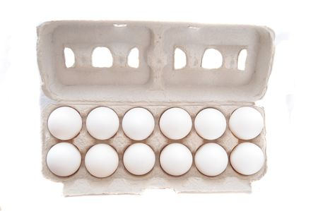 Dozen of Eggs in Egg cartion isolated on white Stock Photo - 6814000