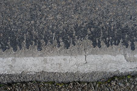 Closeup of really rough cracked rocky grunge asphalt background texture. photo