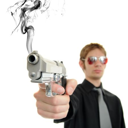 aviators: Young man holds his pistol out and shoots out smoke