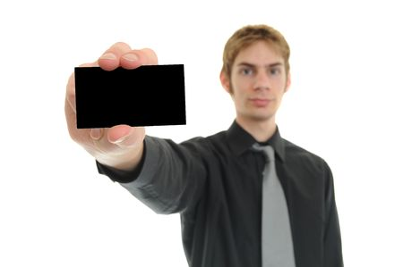 businesscard: Young businessman holds up his black blank business card Stock Photo