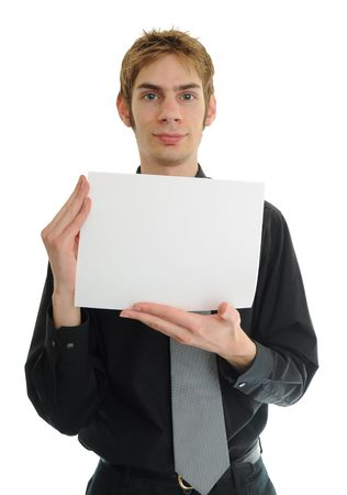 Young adult man in black suit and tie holds a white blank piece of paper photo