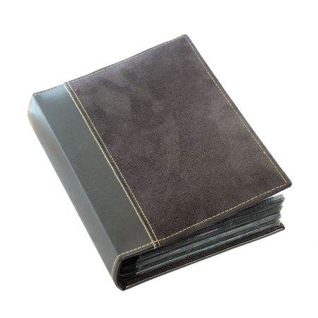 A closed black leather photo album isolated on white background Zdjęcie Seryjne