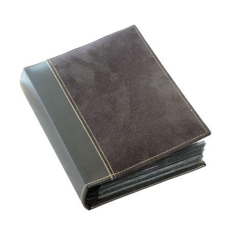 A closed black leather photo album isolated on white background Archivio Fotografico