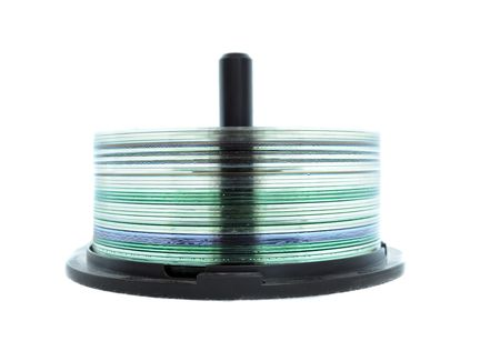 A CD Spindle filled with CDs isolated on a white background Stock Photo