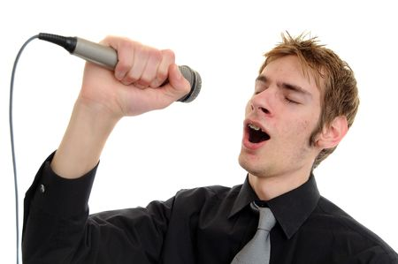 kareoke: Young man sings into a karaoke microphone isolated on white