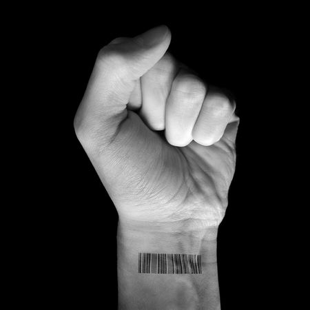 revolt: White fist raising his clenched fist with a bar code printed on his wrist. Stock Photo