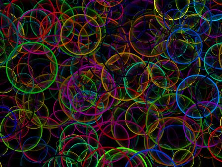 Abstract colorful rainbow vibrant circles on black background. Stok Fotoğraf