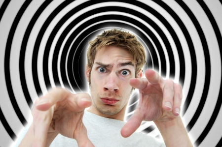 hypnosis: Image of a hypnotist brainwashing the viewer into a deep subconscious subliminal trance using secret mind control tactics. Stock Photo
