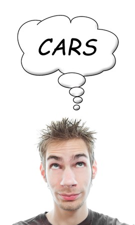 Young adult thinks about cars isolated on white background with a cartoon think bubble.