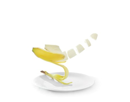 Healthy lifestyles include eating delicious healthy organic fruits including sliced banana floating on plates. photo